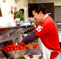 Meals are created with the help of staff such as Raul Corona